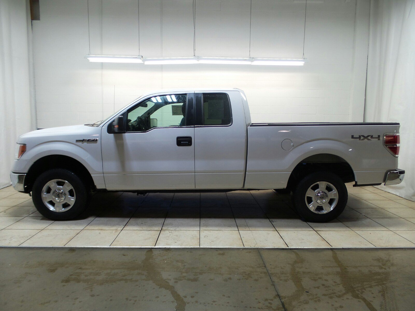 pre owned 2014 ford f 150 4wd supercab 145 xlt extended cab pickup in morton d19690 mike. Black Bedroom Furniture Sets. Home Design Ideas